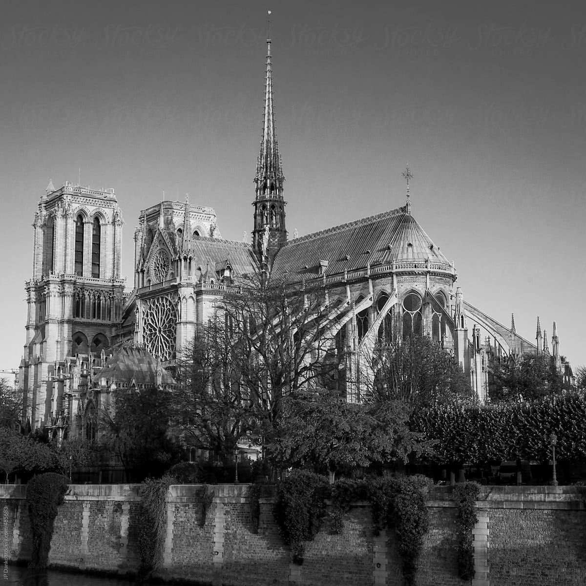 Black and white vintage film medium format style photograph of notre dame de paris by jp
