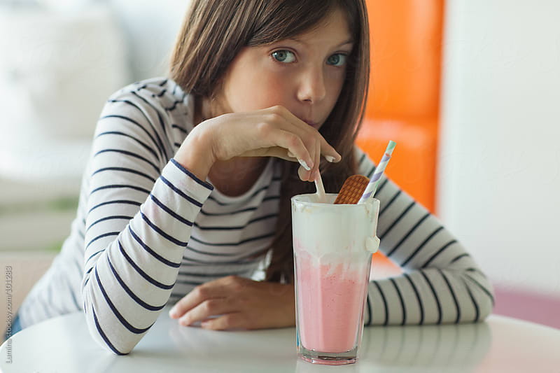 Girl Drinking Strawberry Milkshake by Lumina for Stocksy United