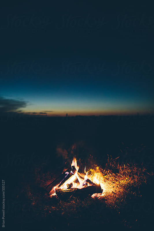 campfire at dusk by Brian Powell for Stocksy United