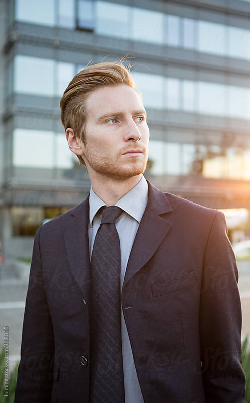 Outdoor Portrait of a Young Businessman by Lumina for Stocksy United