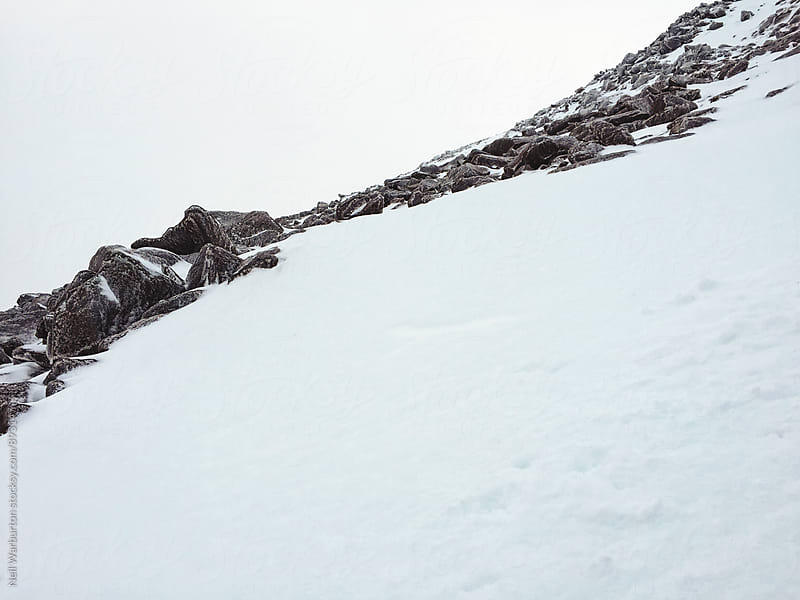 Snow and Rock by Neil Warburton for Stocksy United