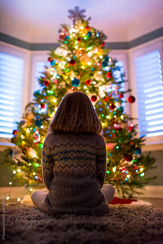 Little Girl Sitting In Front of Christmas Tree by JP Danko for Stocksy United