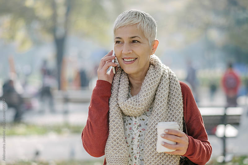 Smiling Senior Woman Talking on the Phone by Aleksandra Jankovic for Stocksy United