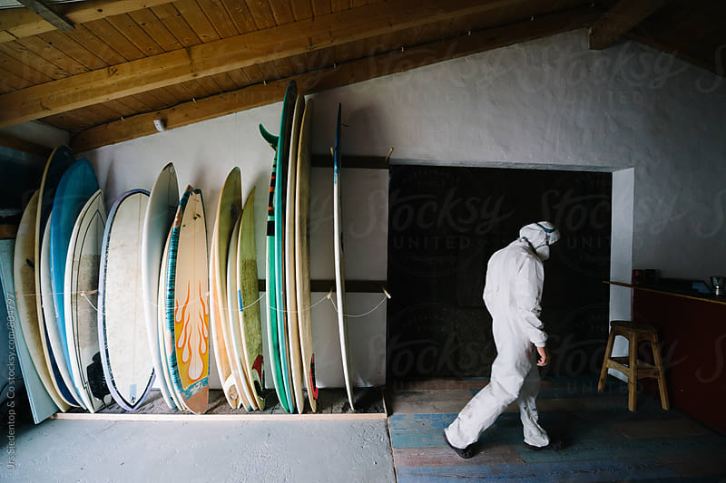 Surfboards in shaper's showroom by Urs Siedentop & Co for Stocksy United