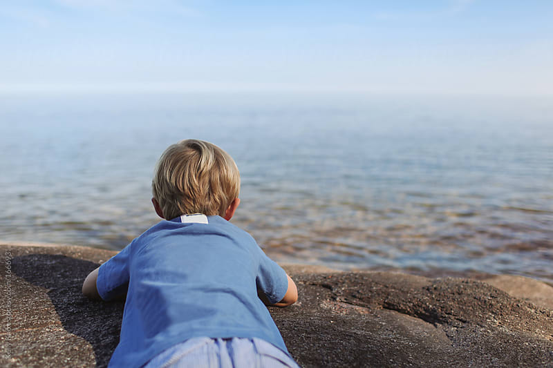 boy taking in the view by Kelly Knox for Stocksy United