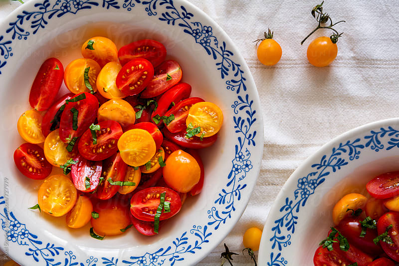 Cherry tomato salad by Pixel Stories for Stocksy United