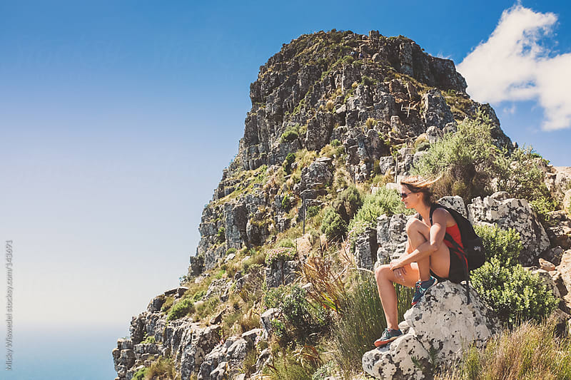 Young active woman relaxing near a mountain top enjoying the view by Micky Wiswedel for Stocksy United