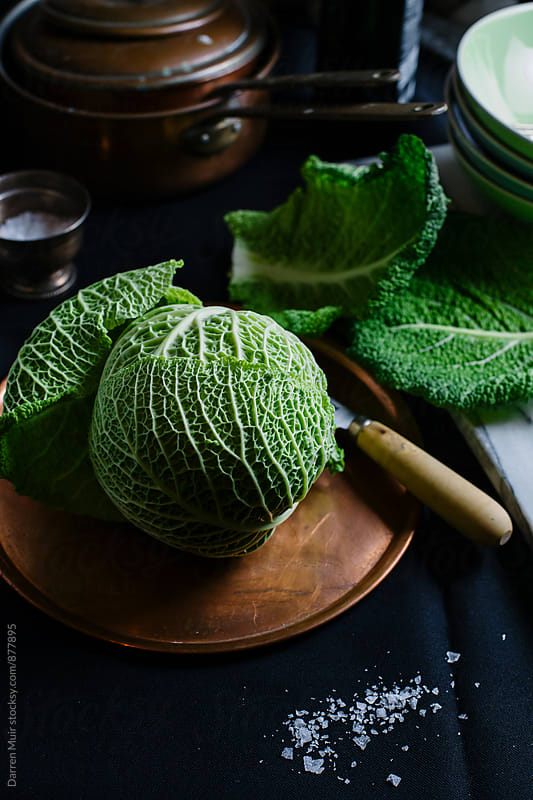 Preparing savoy cabbage for cooking. by Darren Muir for Stocksy United