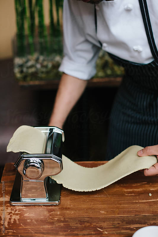 Chef Puts Handmade Pasta Through Roller by Grady Mitchell for Stocksy United