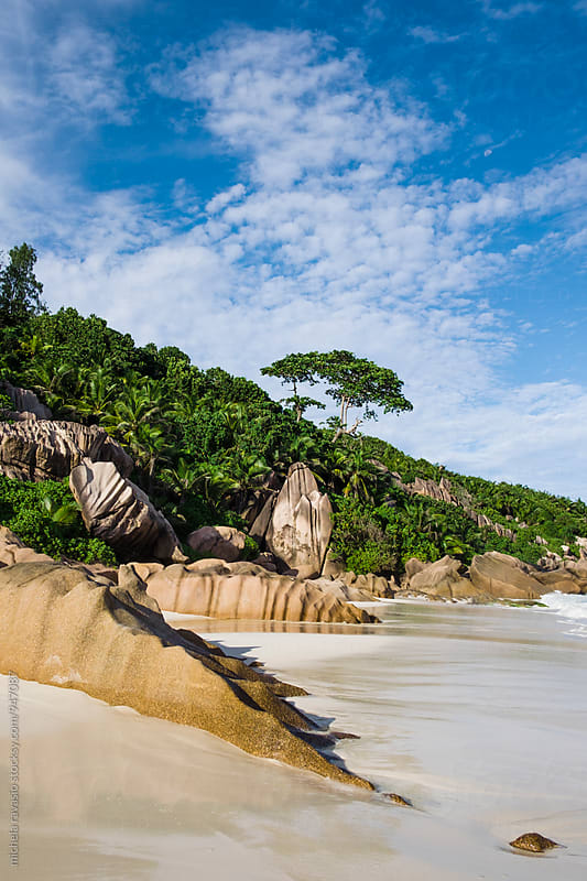Granite rocks on the beach, Petite Anse, La Digue by michela ravasio for Stocksy United