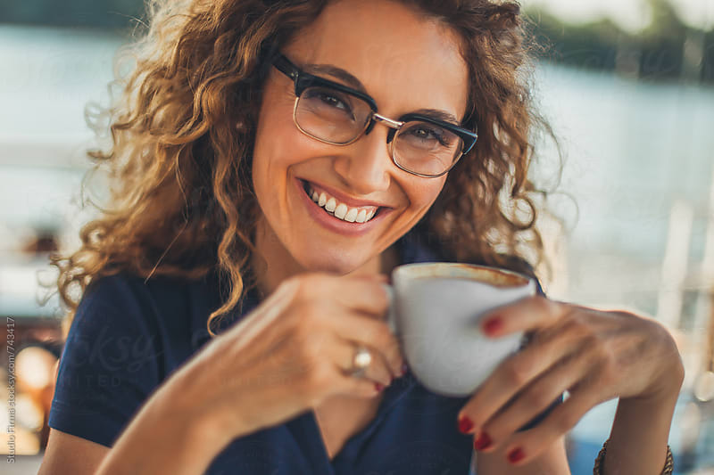 Businesswoman Drinking Coffee by Studio Firma for Stocksy United