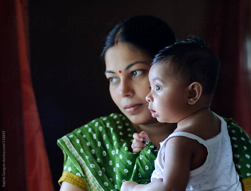 Baby girl with her mother by Saptak Ganguly for Stocksy United