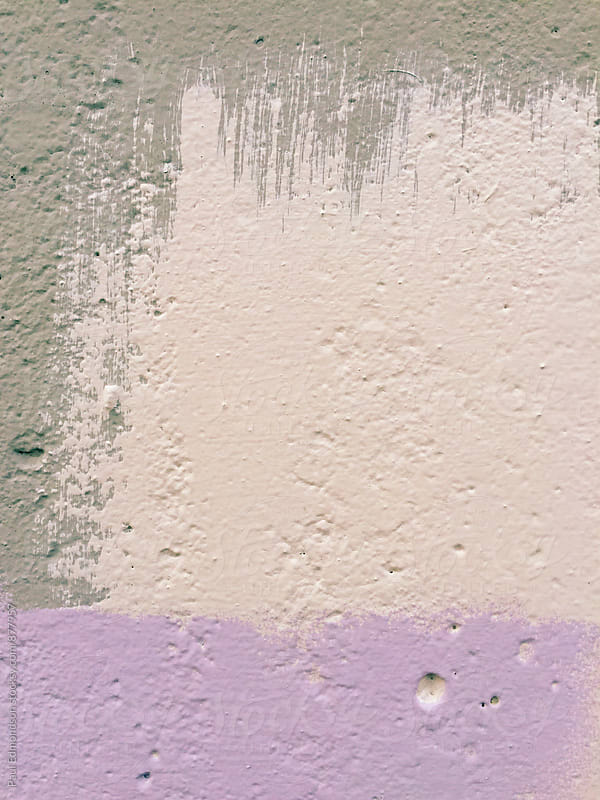 Detail of paint covering graffiti tags on wall by Paul Edmondson for Stocksy United
