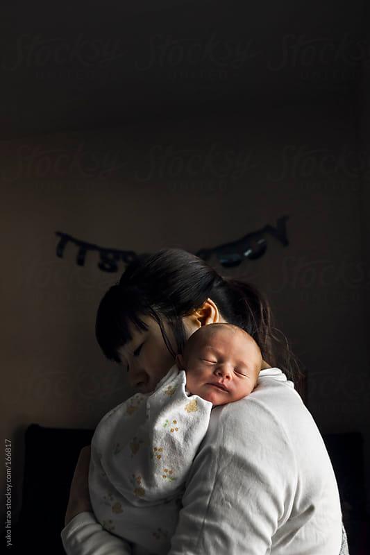 Postpartum depression: sleeping newborn in a dark room by yuko hirao for Stocksy United