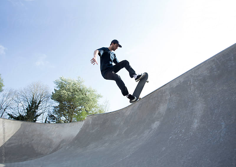 Skateboarder practising skills.  by Hugh Sitton for Stocksy United
