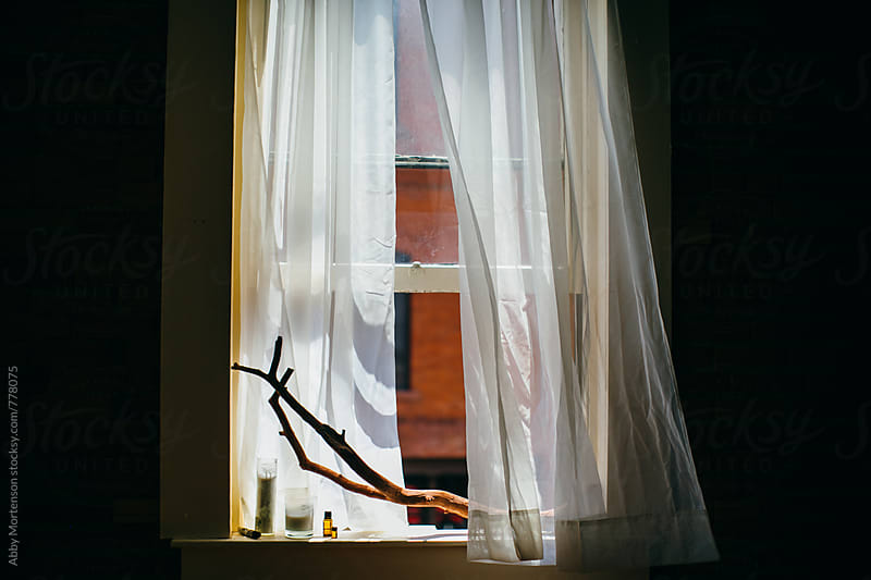 Window with Curtains Blowing in the Wind by Abby Mortenson for Stocksy United