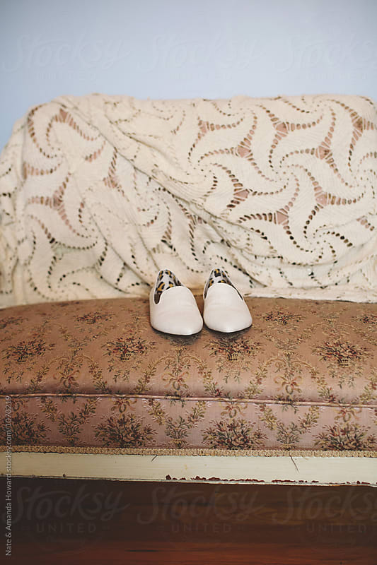 shoes on victorian couch by Nate & Amanda Howard for Stocksy United