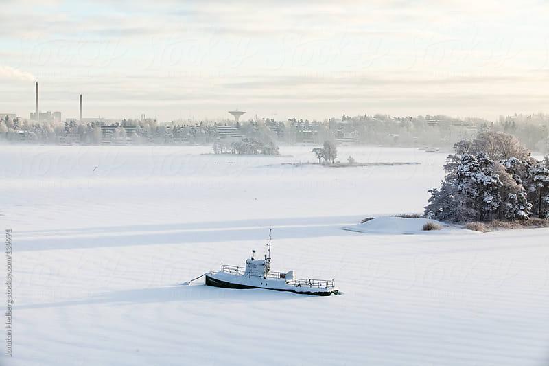 Frozen boat by Jonatan Hedberg for Stocksy United
