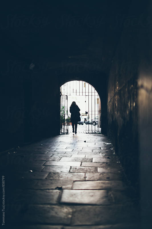 Woman walking on old street in Rome by Tommaso Tuzj for Stocksy United