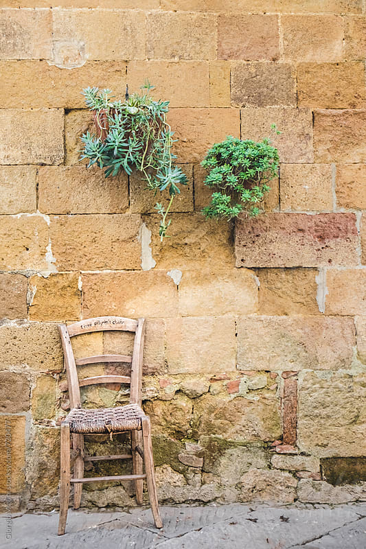 Wooden Chair and Potted Plants on an Old Stone Wall, Italy by Giorgio Magini for Stocksy United