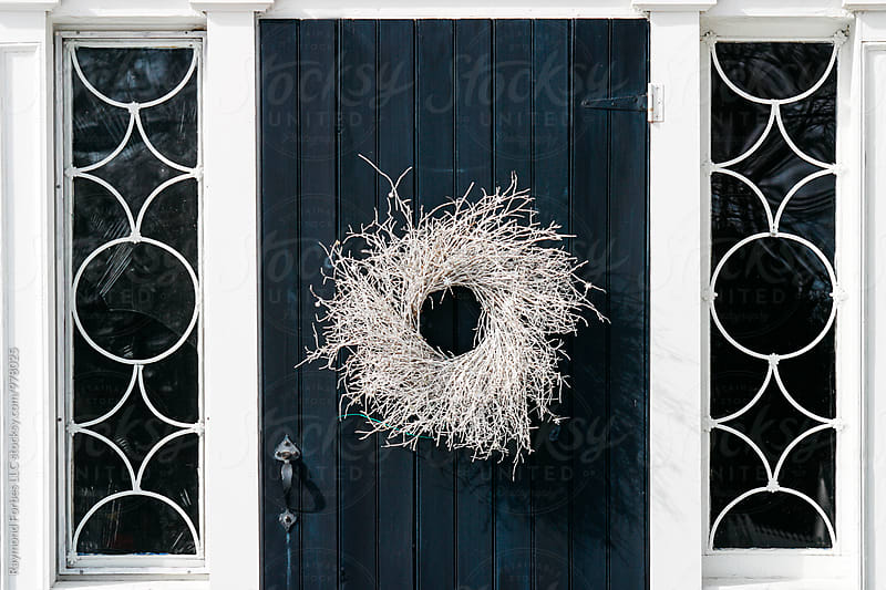 Winter Wreath on Front Door by Raymond Forbes LLC for Stocksy United