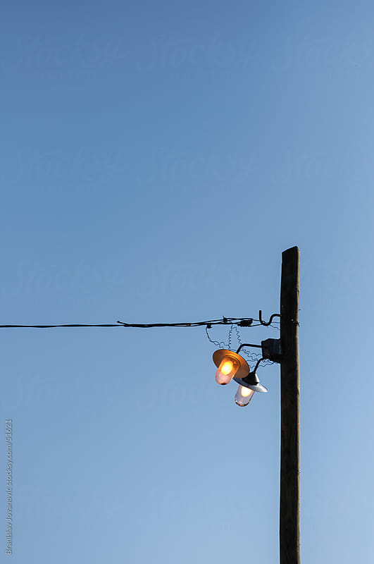 Street lights turned on during the day by Branislav Jovanovic for Stocksy United