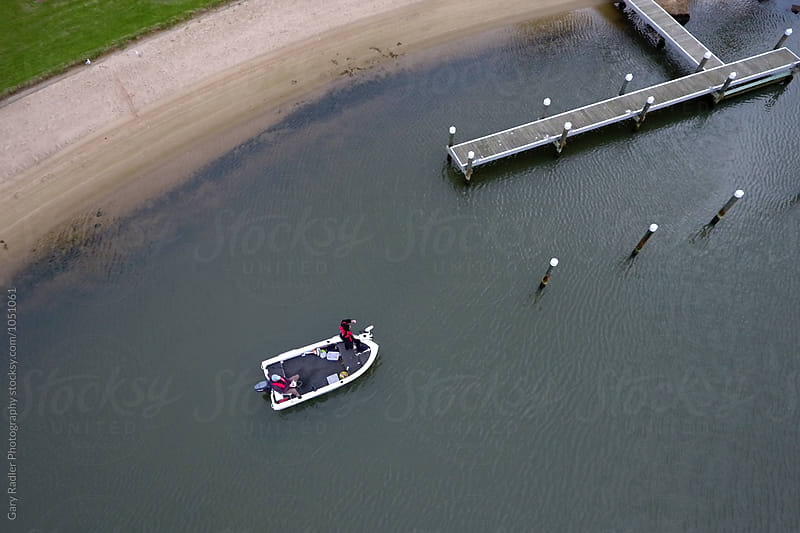 Looking Down on Two Fishermen in a Small Boat by Gary Radler Photography for Stocksy United