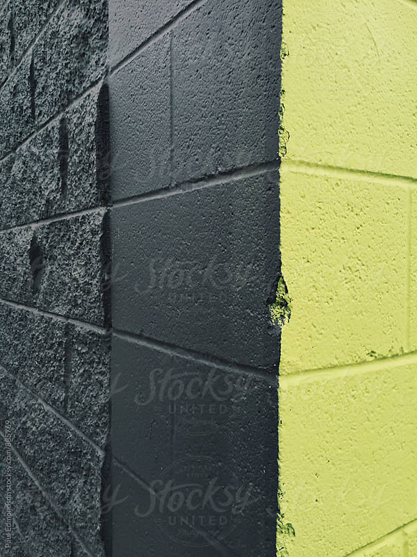 Detail of painted yellow and black building corner by Paul Edmondson for Stocksy United