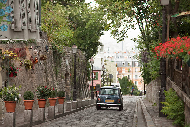 Car in the beautiful neibourhood of  Montmartre. by Oscar Parasiego for Stocksy United