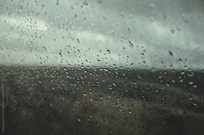 view out a ferry window on a stormy day by Margaret Vincent for Stocksy United