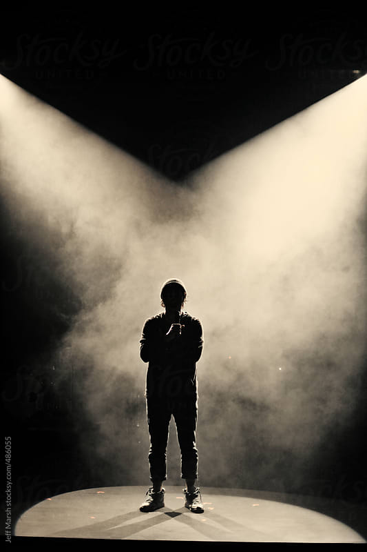 Musician in fog by Jeff Marsh for Stocksy United