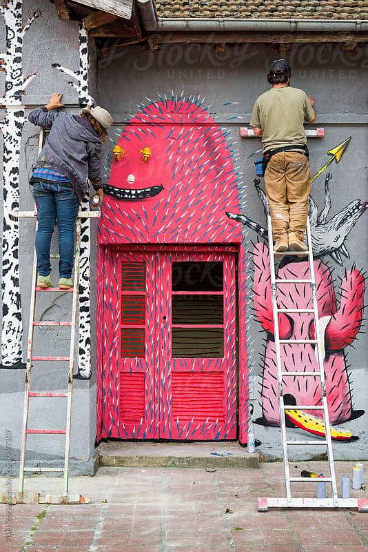 Two graffiti artists on ladders by Pixel Stories for Stocksy United