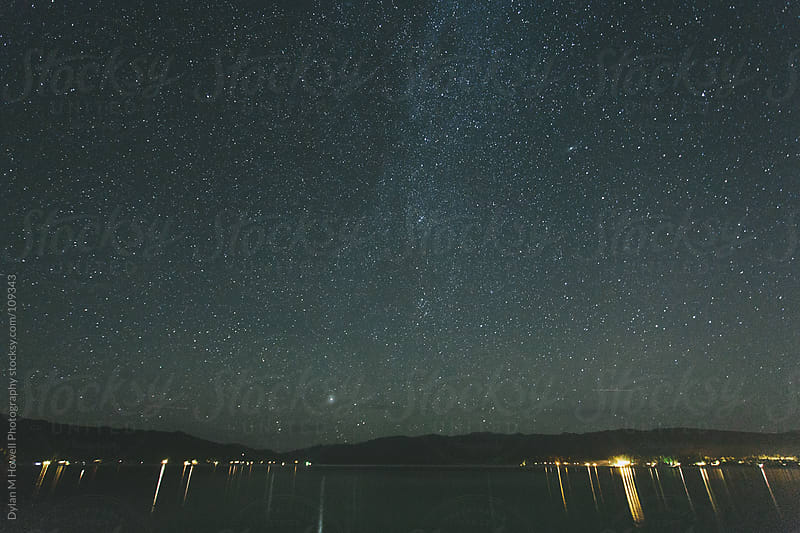 Night shot over mountain lake. by Dylan M Howell Photography for Stocksy United