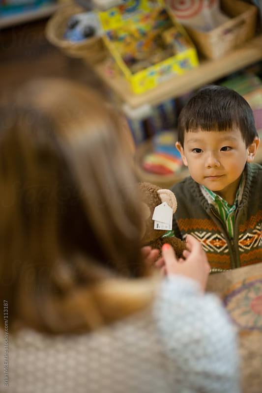 Adorable Buy Buys Stuffed Animal In Toy Store by Brian McEntire for Stocksy United