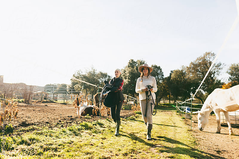 Women farmers walking in a ranch. by BONNINSTUDIO for Stocksy United