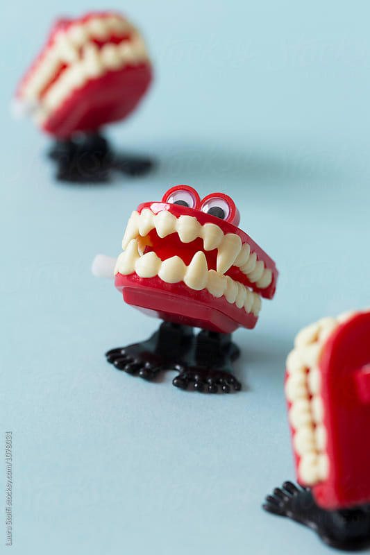 Marching dentures with vampires canine teeth by Laura Stolfi for Stocksy United