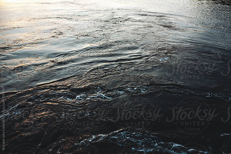 Swirling boat water at dusk by Rob and Julia Campbell for Stocksy United