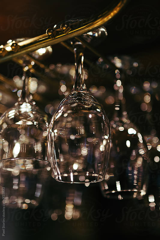 Glass rack in a bar by Pixel Stories for Stocksy United