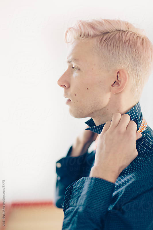 Portrait of a pink haired young man by Ania Boniecka for Stocksy United