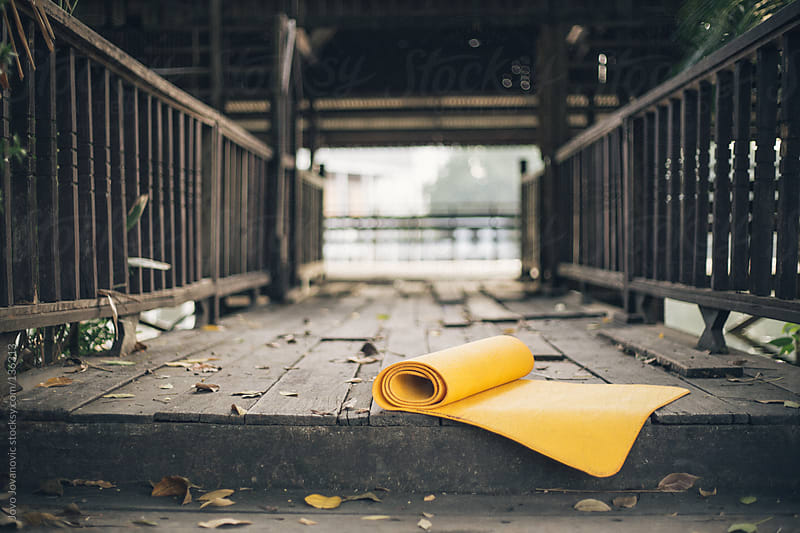 Yellow yoga mat outdoors by Jovo Jovanovic for Stocksy United