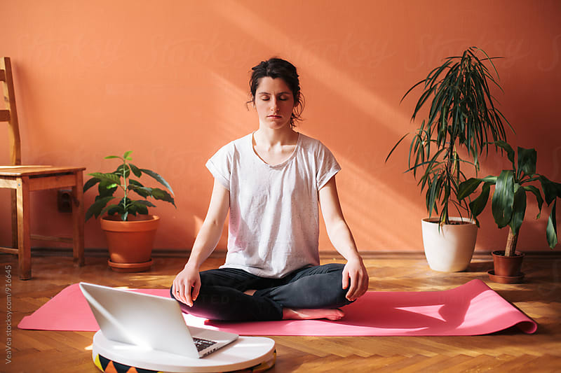 Woman doing yoga by Marija Mandic for Stocksy United