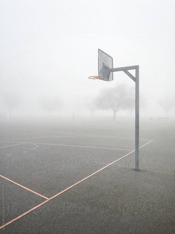 Basketball hoop in dense fog by James Ross for Stocksy United
