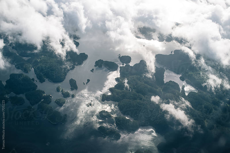 Islands near the shore and clouds by Tomas Mikula for Stocksy United