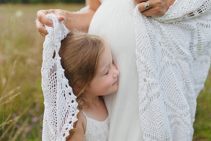 Beautiful young girl wrapped in a lace blanket by mother by Amanda Worrall for Stocksy United