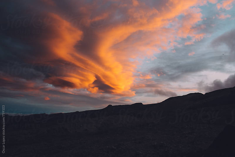 Dramatic Sunrise over the Mountains with Pink Clouds by Oscar Lopez for Stocksy United