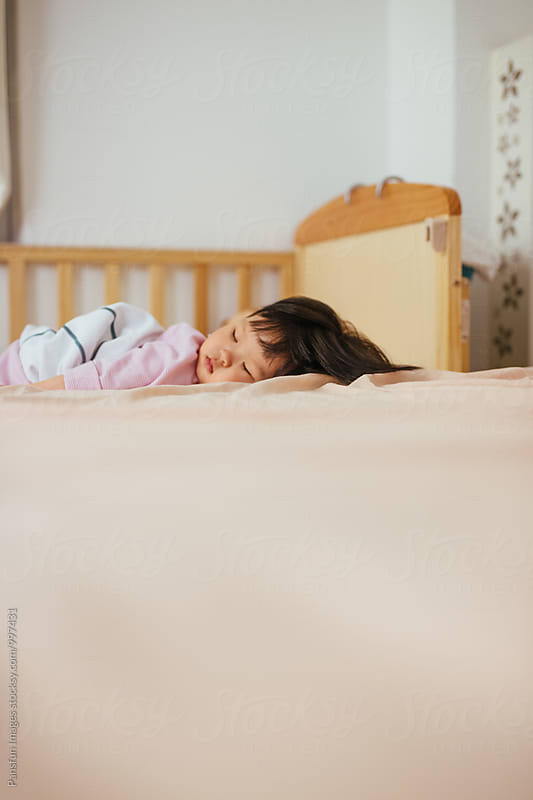 baby girl sleeping by Pansfun Images for Stocksy United