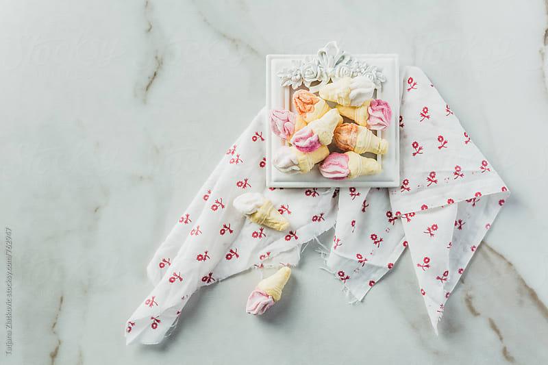 White frame with marshmallows by Tatjana Zlatkovic for Stocksy United