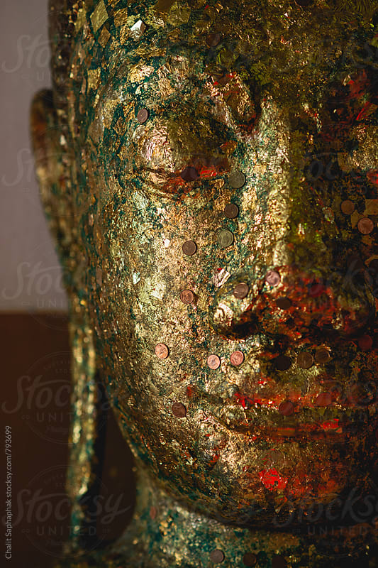 Face of Buddha by Chalit Saphaphak for Stocksy United