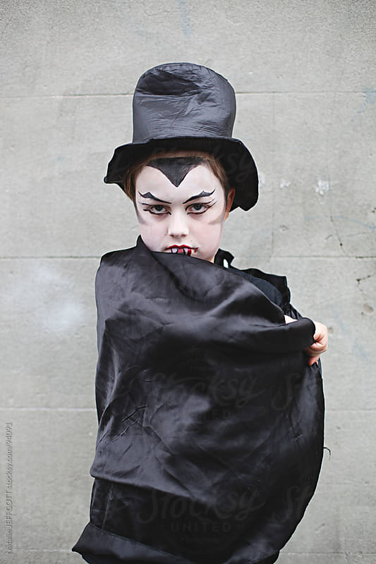 child  dressed as dracula / vampire for Halloween by Natalie JEFFCOTT for Stocksy United