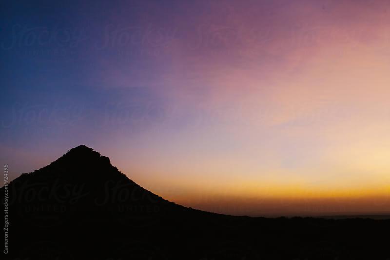 sunset over Oldonyo Sambu mountain, Tanzania by Cameron Zegers for Stocksy United